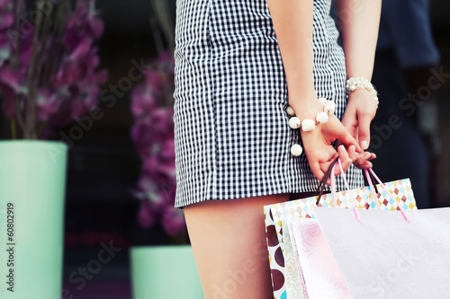 Female hands holding shopping bags