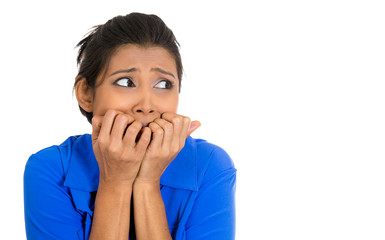 Anxious, horrified, concerned  woman biting fingernails