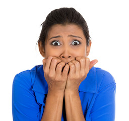 Anxious, horrified, concerned  woman biting fingernails