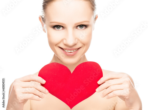face of a beautiful young woman with red heart