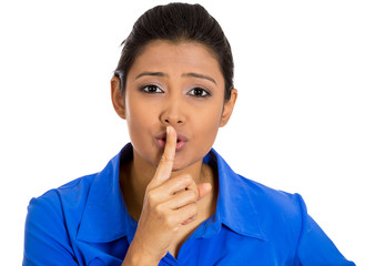 Woman placing finger on lips asking quiet isolated on white