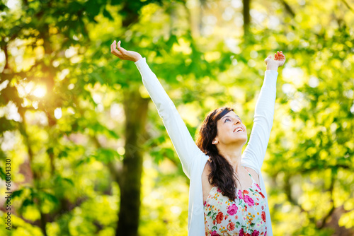 Blissful woman enjoying freedom on spring