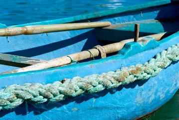 Closeup of a small blue Maltese fishing boat.