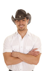 cowboy arms crossed smile white shirt