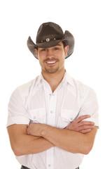 cowboy arms crossed smile white shirt