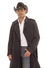 cowboy in coat hand in pocket