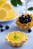 Delicious tarts with lemon cream and blueberries.