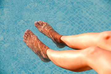 Soaking the feet in the pool