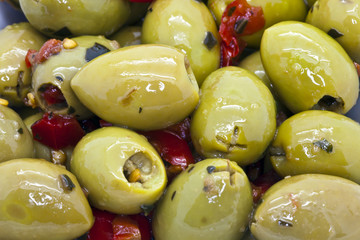 Spicy green olives close-up.