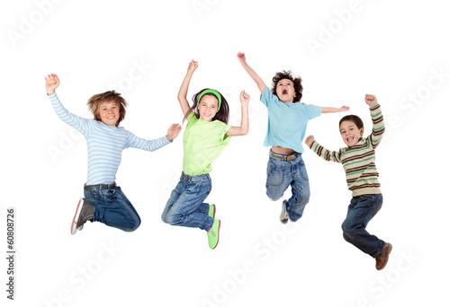 Four joyful children jumping