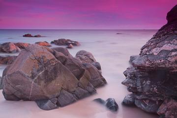 Purple skies over ocean