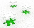 White puzzle on green background. Isolated 3D image