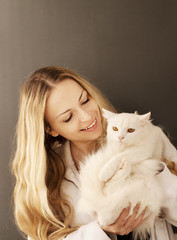 Beautiful girl holding Persian cat