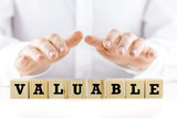 The word - Valuable- on wooden cubes