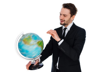 Businessman spinning a globe of the world