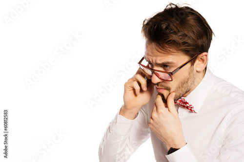 Nerdy businessman talking on a smartphone