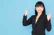 asian businesswoman cheering on blue background