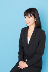 asian businesswoman interviewing on blue background