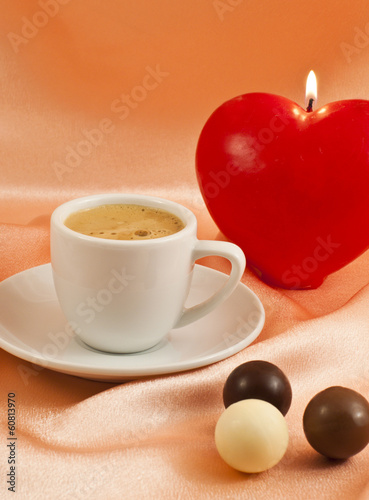 Cup of coffee with chocolates on  silk