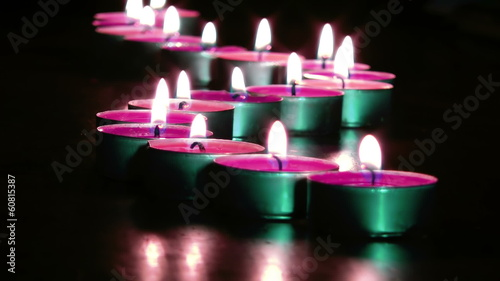Warm Romantic Pink Candles Against Black Background