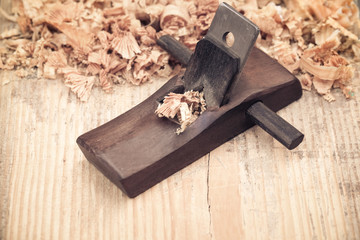 wood planer on wooden background