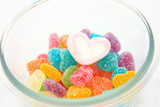 marshmallows and candy in a bowl isolated