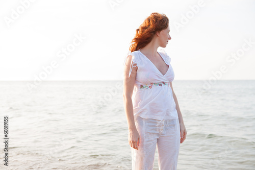pregnant woman in beach with white light in Mediterranean