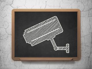 Safety concept: Cctv Camera on chalkboard background