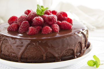 Chocolate cheesecake with raspberries.