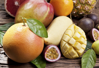 Exotic fruits on a wooden table.