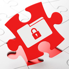 Finance concept: Folder With Lock on puzzle background