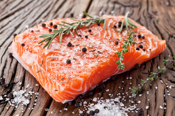 Salmon filet on a wooden carving board.