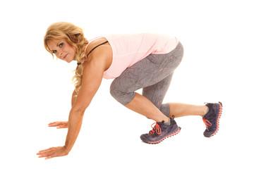 Mature woman run start position side