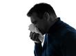 man sneezing silhouette portrait