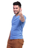 smiling casual man making the ok sign