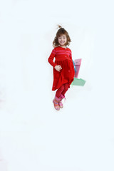 Beautiful girl jumping with colorful shopping bags