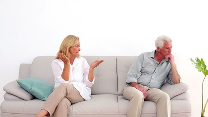 Retired couple arguing on the couch