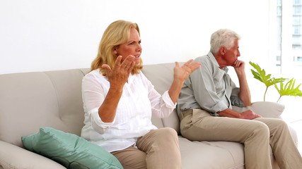 Retired couple fighting on the couch