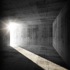 Abstract empty dark concrete interior with sunlight beam