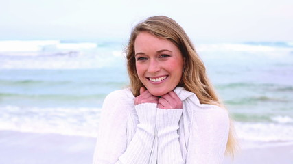 Portrait of a smiling casual young woman at beach