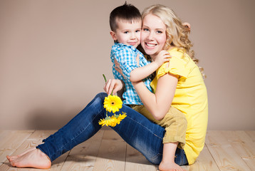 young mother and small son having fun. Family, adorable kid