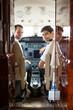 Pilot And Copilot In Corporate Plane Cockpit