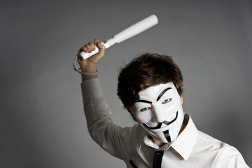 man in mask brandishing a truncheon