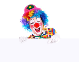 Horizontal  portrait of a clown pointing to the blank board