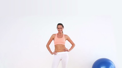 Fit model dancing and smiling at camera