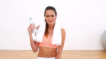 Fit model drinking bottle of water