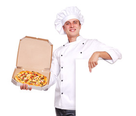 Chef holding the pizza in a box pointing to the blank board