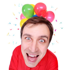 Comic face of a happy man with balloons background