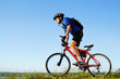 Active bicyclist riding at the countryside