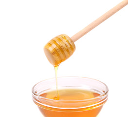 Bee honey with wooden dipper.